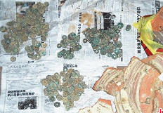 Some of the coins discovered in the Hunan coin pit