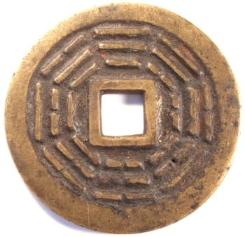 Large Chinese charm displaying               bagua (eight trigrams)