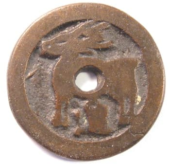 Reverse side of         charm or game piece displaying a deer and a Chinese character