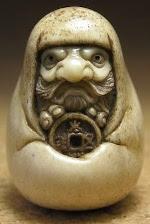 Bodhidharma Holding a Wu Zhu Coin thumbnail