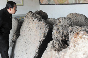 Large chunks of the unearthed iron coins on display