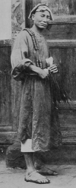 Photograph of a man carrying cash coins during the Qing Dynasty