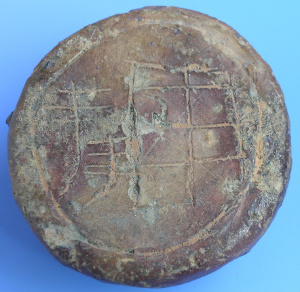 """Clay gold pie coin with inscription """"fields of bountiful harvest"""""""