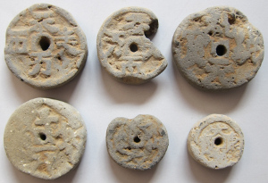 Clay burial coins from the Liao Dynasty