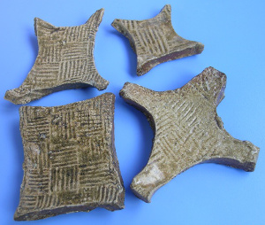 "Clay versions of State of Chu gold plate money (泥""郢称""(楚国黄金货币)) found buried in tombs of the Warring States Period"