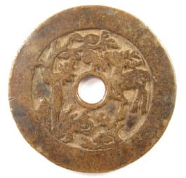Reverse side of           old Chinese charm showing deer, bat and other symbols