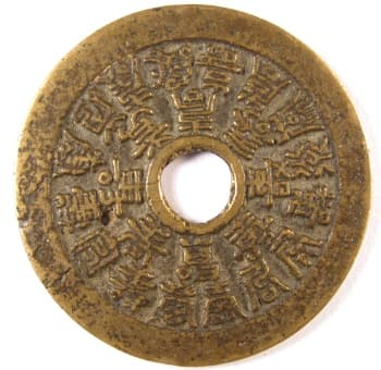 Old charm with 24           longevity characters on reverse side