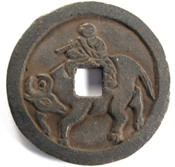"Reverse                   side of ""hong wu tong bao"" charm showing a                   boy (Emperor Tai Zu of the Ming Dynasty) riding an ox                   (water buffalo)"