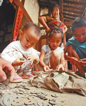 Children playing with ancient Chinese coins