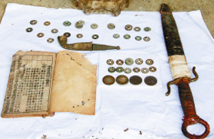 Unearthed coin cache included a sword and copy of Book of Songs