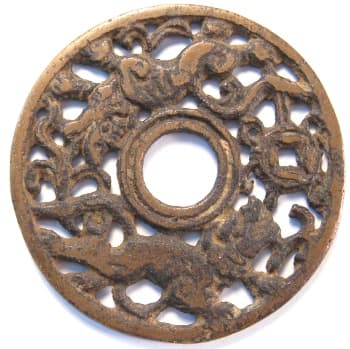 Chinese open work charm displaying               two lions playing with a treasure coin