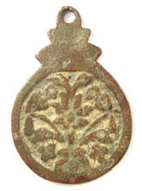 Reverse side of loop charm showing tree and two birds
