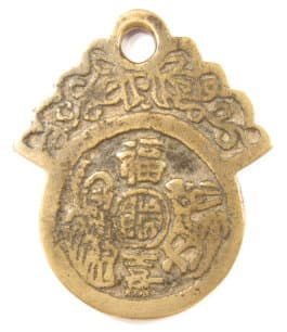 Reverse side of old loop charm with three characters and a deer and immortal
