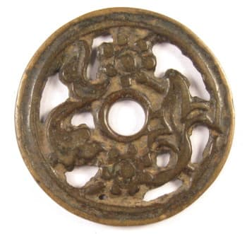 Old open             work charm displaying two mudan flowers