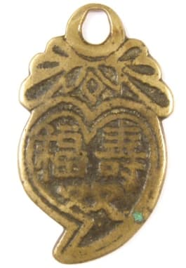 Chinese peach charm       with inscription longevity, good fortune, wealth and rank