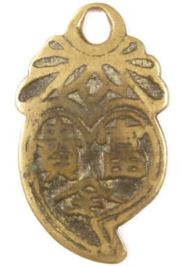 Reverse side of Chinese peach charm with inscription longevity, good fortune, wealth and rank