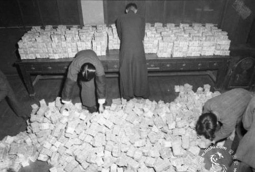 Local bank employees preparing for a customer's cash withdrawal