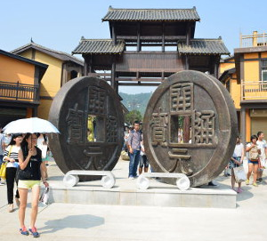 Large sculptures of 'Kai Yuan Tong Bao' coins at entrance to the exhibition