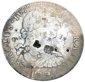 Spanish silver dollar found in pile of dirt