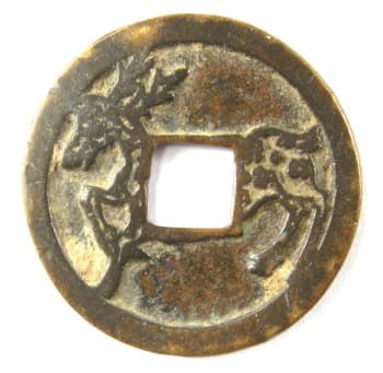 Reverse side of old chinese charm showing a deer