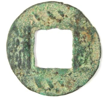 Wu zhu coin with           three slanted lines above and three slanted lines below the           square hole