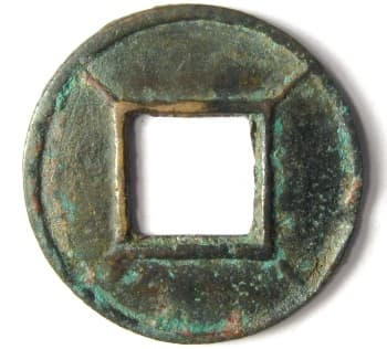 Wu zhu coin with           lines radiating from corners of hole