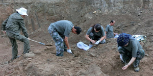 Archaeologists Digging at Excavation Site