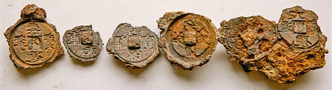Several of the better preserved clay coin moulds